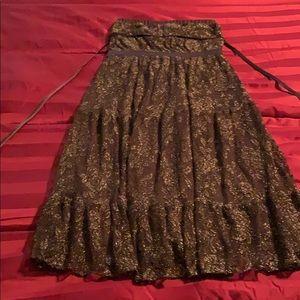 Strapless elegant medium length dress.